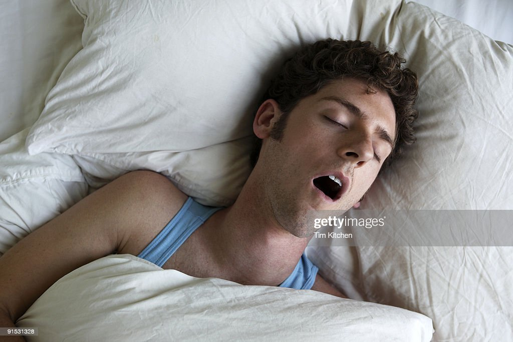 Man sleeping and snoring, overhead view : Stock-Foto