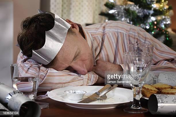 Man sleeping at dining table