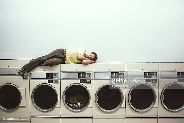 Man Sleeping at Laundromat