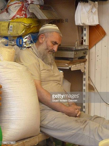 Man sleeping at work in the animal market by the Spice Bazaar Istanbul