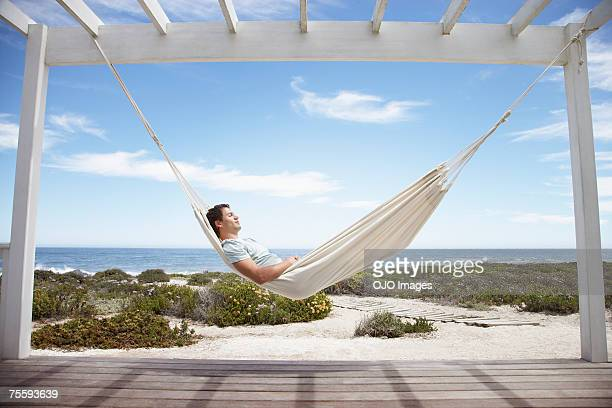 man sleeping in a hammock - hammock stock pictures, royalty-free photos & images