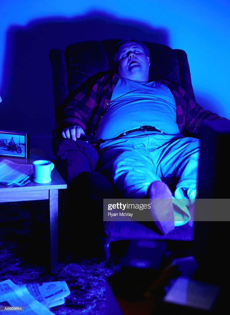 Marvelous Man Sleeping In A Recliner Chair By A Television High Res Pdpeps Interior Chair Design Pdpepsorg