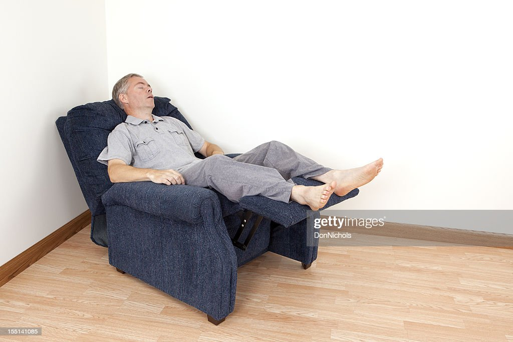Man Sleeping In A Recliner
