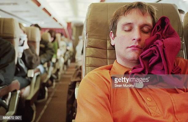 Man sleeping in aeroplane