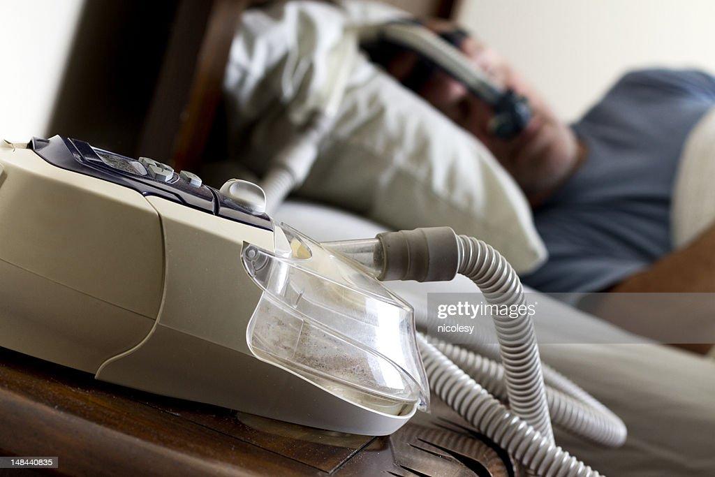 Man Sleeping in Bed with Sleep Apnea Mask : Stock Photo