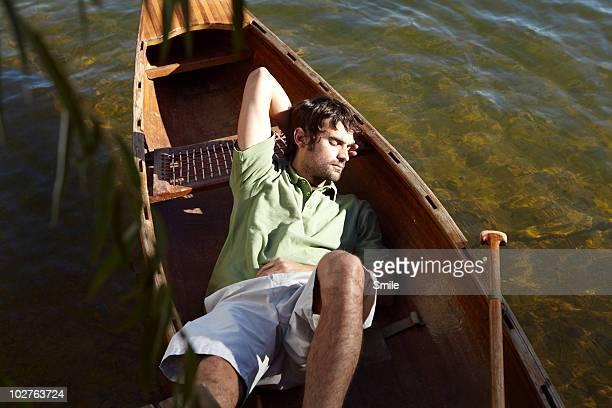 Man sleeping in canoe
