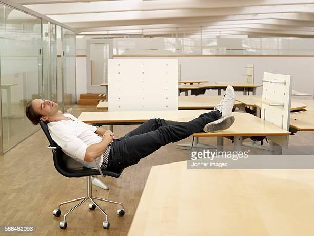 Man sleeping in empty office