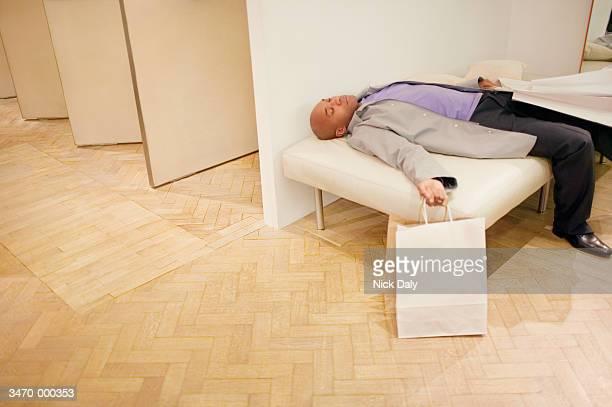 Man Sleeping in Fitting Room