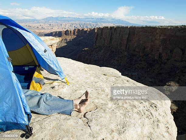 man sleeping in tent on cliff, moab, utah, usa - low section stock pictures, royalty-free photos & images