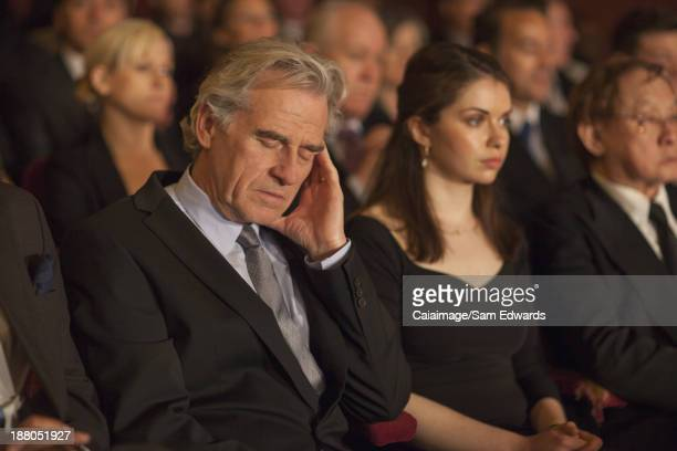 Man sleeping in theater audience