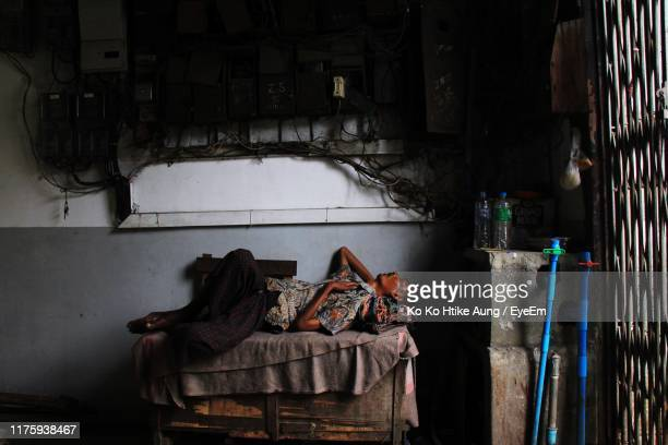 man sleeping on bed against wall - ko ko htike aung stock pictures, royalty-free photos & images