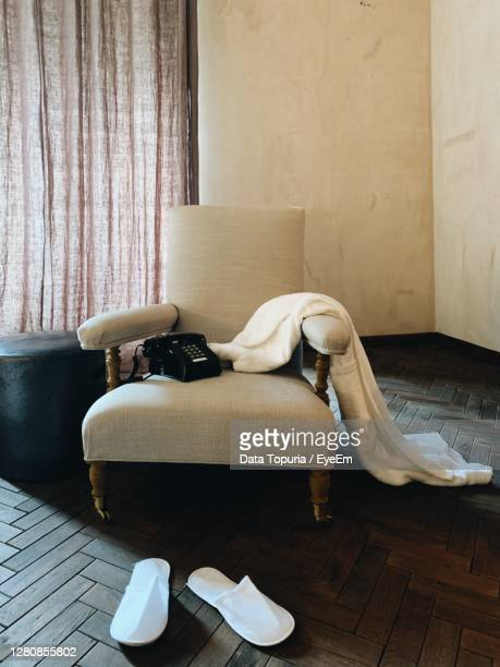 man sleeping on sofa at home - data topuria stock pictures, royalty-free photos & images