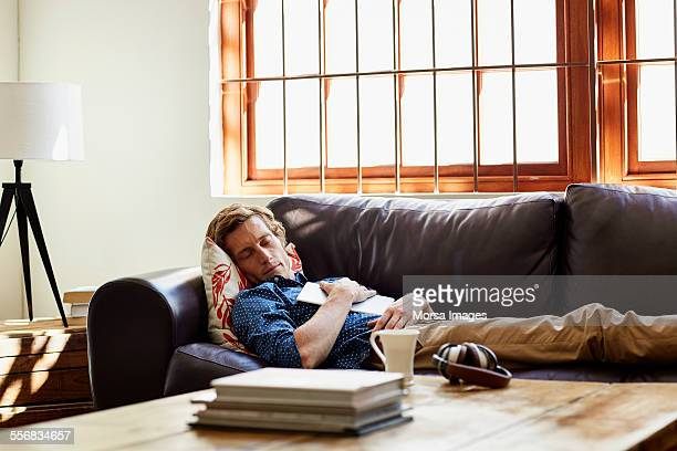 Man sleeping on sofa at home
