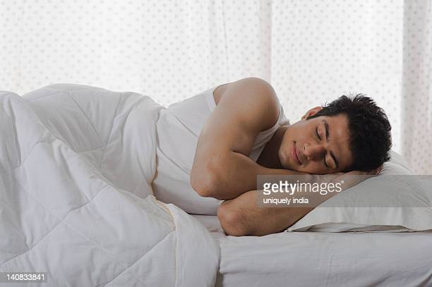 man sleeping on the bed - lying on side stock pictures, royalty-free photos & images