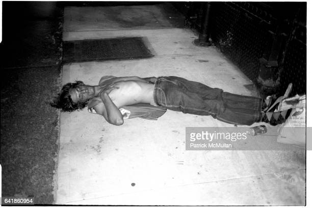 Man sleeping on the street in the East Village July 1984