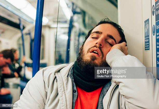 Man sleeping on the subway