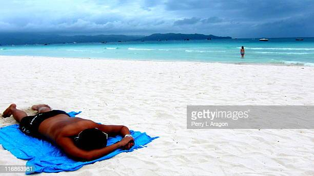 Man Sleeping on White Beach