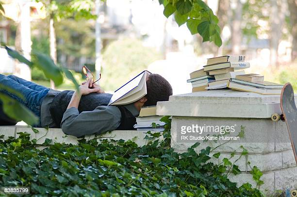 Man sleeping while studying on College campus