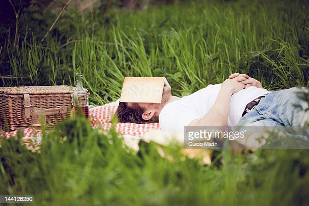 Man sleeping with book