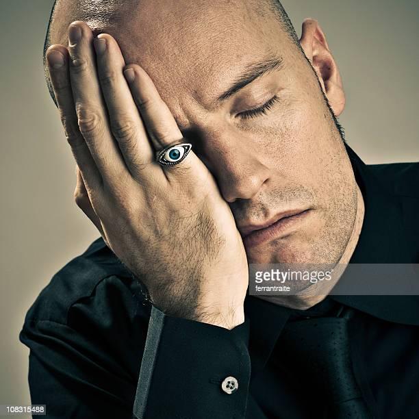 Man sleeping with one eye opened.
