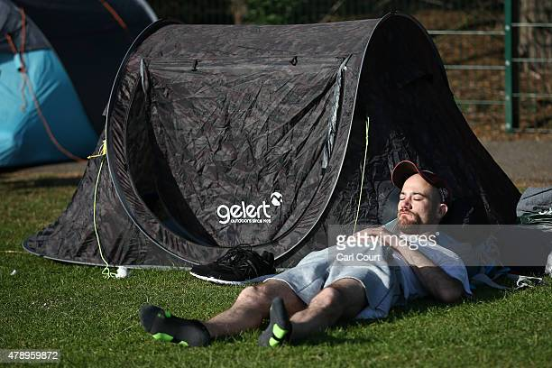 A man sleeps as he queues to attend the Wimbledon tennis tournament on June 29 2015 in London England The 129th tournament to be hosted at Wimbledon...
