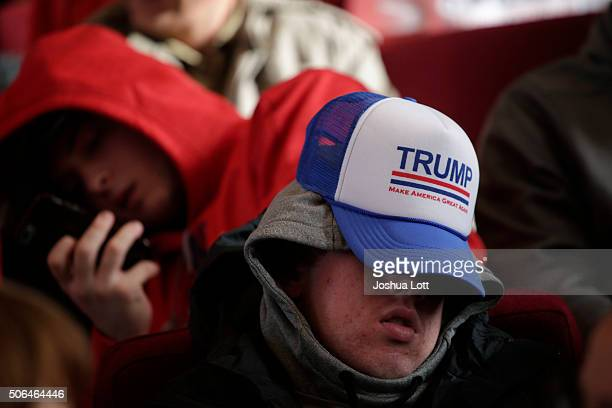 A man sleeps before a campaign event for Republican presidential candidate Donald Trump January 23 2016 in Pella Iowa Trump who is seeking the...