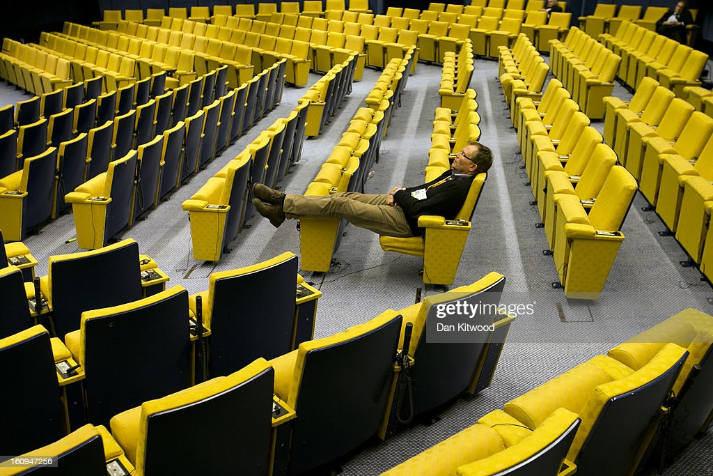 A man sleeps in the main hall at the headquarters of the Council of the European Union on February 8, 2013 in Brussels, Belgium. EU leaders have set out the framework for agreeing on a 2014-2020 EU budget during talks that continued through the night at the European Council Meetings in Brussels. The historic deal would see 34.4 billion Euros of EU spending cuts over the next 7 year period.