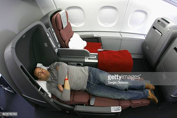 A man sleeps in the new business class seat onboard the new Qantas A380 flagship the 'NancyBird Walton' as she joins the Qantas fleet at Sydney...