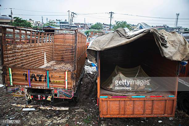A man sleeps in the rear of a truck parked at the Sanjay Gandhi Transport Naga depot in New Delhi India on Thursday Aug 22 2013 Indias rupee plunged...