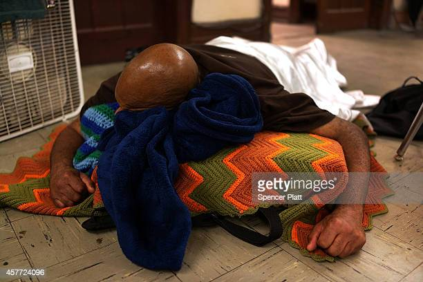 A man sleeps inside of a church which serves as a shelter in the evenings on October 22 2014 in Philadelphia Pennsylvania The program for homeless...
