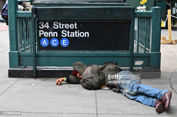 A man sleeps near Penn Station by Madison Square Gardens on September 17 2020 in New York City