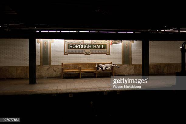 A man sleeps on a bench June 8 2010 in Brooklyn New York New York's Metropolitan Transit Authority recently voted to raise subway bus and railroad...