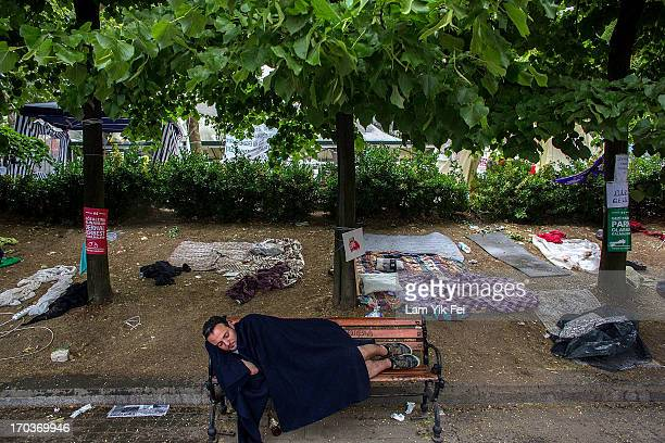 A man sleeps on a chair in Gezi Park the morning after a police crackdown on protesters on June 12 2013 in Istanbul Turkey Istanbul has seen protests...