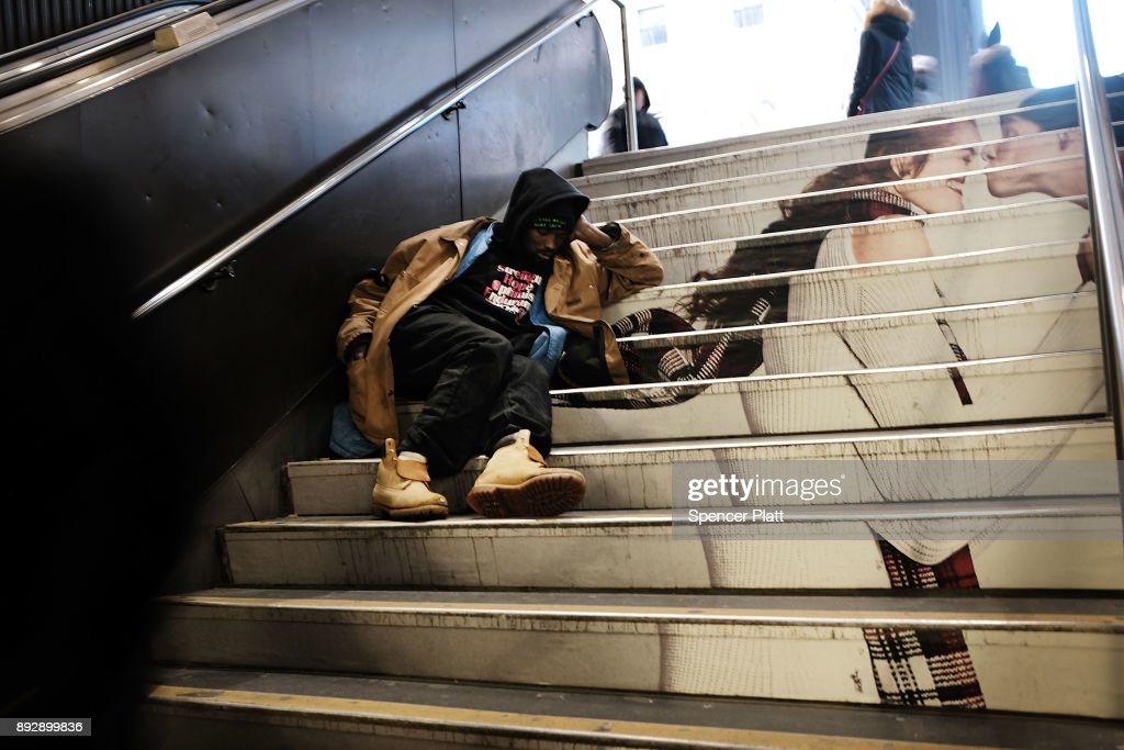 A man sleeps on a set of stairs in Manhattan on December 14, 2017 in New York City. According to a new report released by the U.S. Department of Housing and Urban Development New York City's homeless population expanded by about 4 percent in 2017 as the number of homeless people nationwide grew to about 553,000.