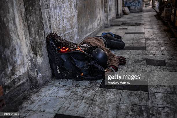 A man sleeps on a walkway outside entrance of one of the squatted apartments during a protest at the Borei Keila site in Phnom Penh Cambodia on...