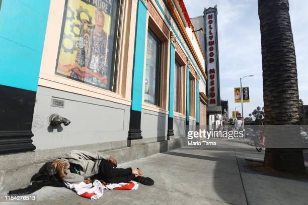 A man sleeps on the street near Hollywood Boulevard on June 06 2019 in Los Angeles California The homeless population count in Los Angeles County...