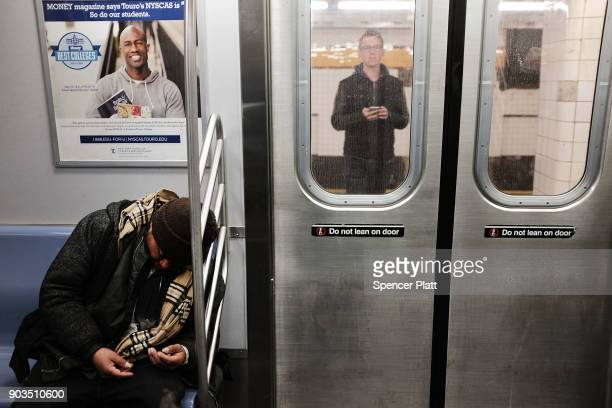 A man sleeps on the subway on January 10 2018 in New York City The New York City subway system which opened in 1904 and is the world's largest rapid...