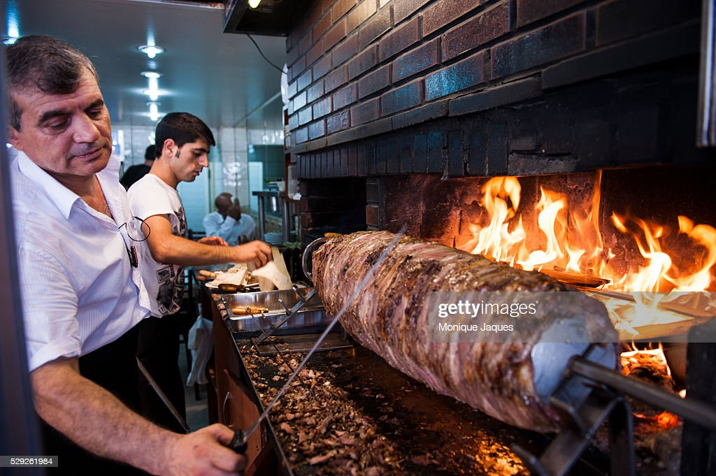 https www gettyimages com detail news photo man slices off a piece of a doner kebab known as cag kebap news photo 529261984