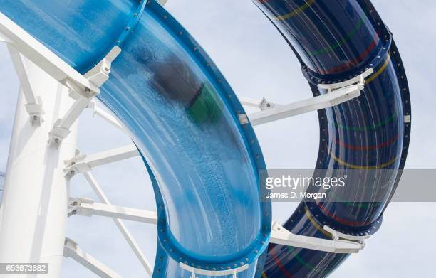 A man slides down a water slide on the Pacific Dawn cruise ship on March 16 2017 in Brisbane Australia The PO Cruises ship is returning to Australia...
