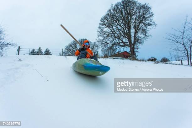 man sliding down snowy hill in kayak - hood river stock pictures, royalty-free photos & images