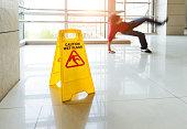 Man slips falling on wet floor