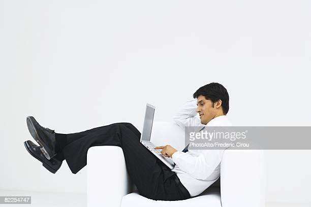 World S Best Man Slouching In Chair Stock Pictures Photos