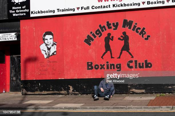 A man slumps on the floor outside Mighty Mick's Boxing Club on October 8 2018 in Grimsby England Grimsby was once home to the largest fleet of...