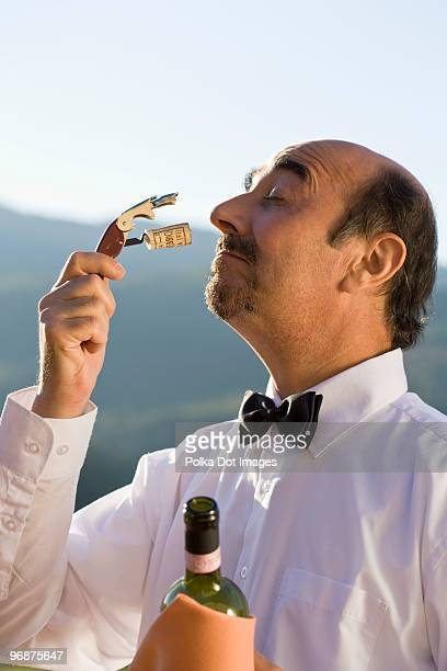 Man smelling cork