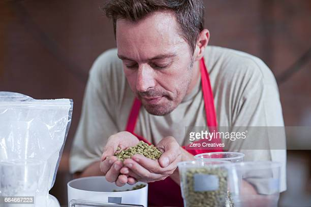 Man smelling handful of grains