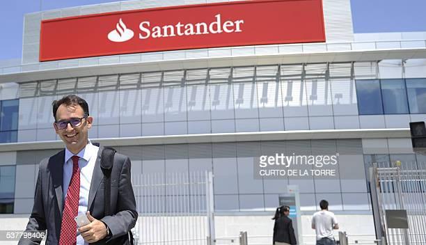 A man smiles as he leaves the Santander Bank's Financial City in Boadilla del Monte near Madrid on June 3 2016 / AFP / CURTO DE LA TORRE