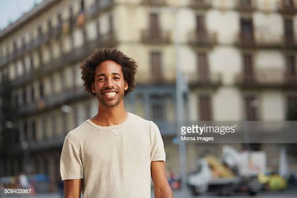 Man smiling against building