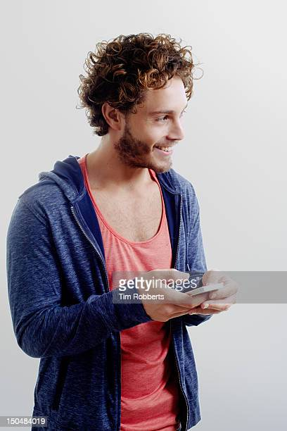 man smiling and using smart phone. - fotosession stock-fotos und bilder