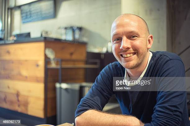 Man smiling at camera in cafe