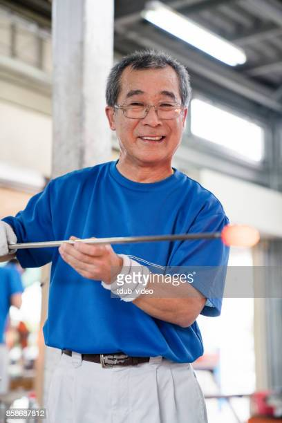 man smiling at camera - tdub_video stock pictures, royalty-free photos & images